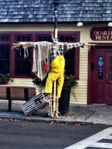 A fun fisherman scarecrow in front of Quarterdeck restaurant