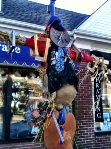 The scarecrow on the lampost in front of Cape Gallery Framer