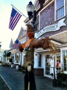 A creative scarecrow in front of Liam Maguire's Pub on Main Street in Falmouth Village