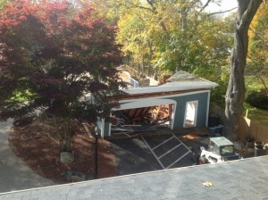 Demolishing the Captain's Manor Garage so we can build a new Carriage House innkeepers quarters