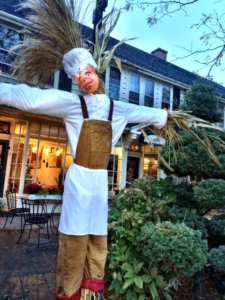 Pickle Jar Restaurant scarecrow in Falmouth Village of Scarecrows