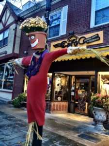 Port Cargo retail shop's scarecrow on the lampost in Falmouth Village of Scarecrows