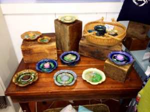 Homespun Gardens carries recycled glass pottery