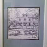 A pen and ink giclee print of the Inn with a blue mat and white frame